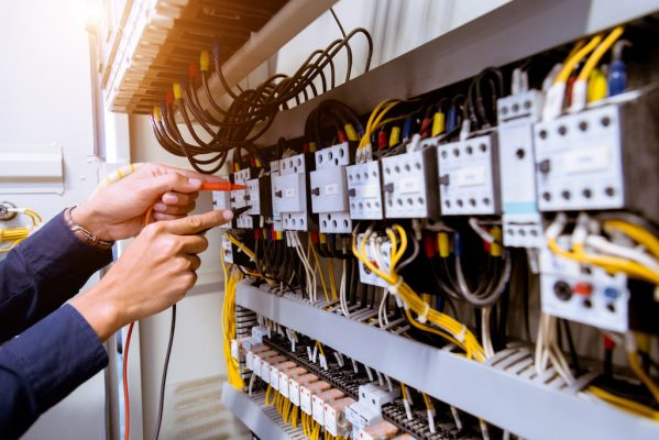 Brisbane electrician at commercial control panel